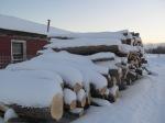 snowy log pile